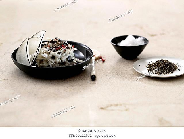 Black radish tartare with ricotta,olives and pepper
