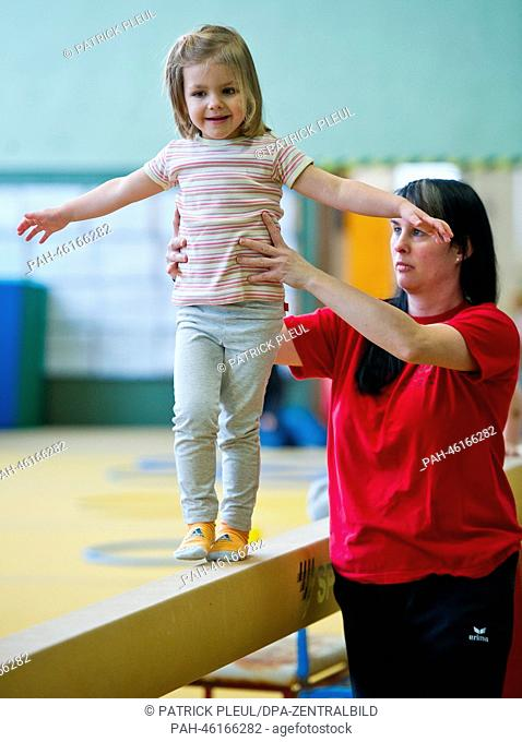 Three-year old Mia from Matroschka Kindergarten plays on the balance beam in Frankfurt Oder, Germany, 30 January 2014. Once a week the three to five year old...