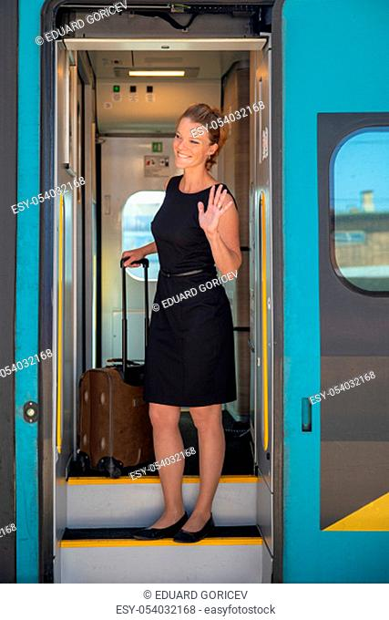 young pretty woman with luggage take the express train from the main station