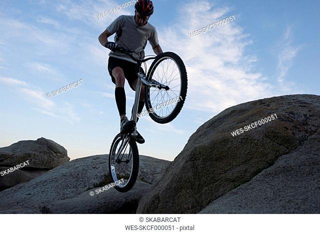 Biker action on the beach Lloret de Mar in the evening
