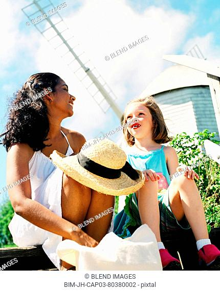 Woman and young girl relaxing in sun