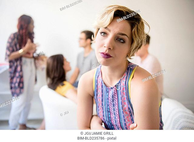 Portrait of woman sulking at party