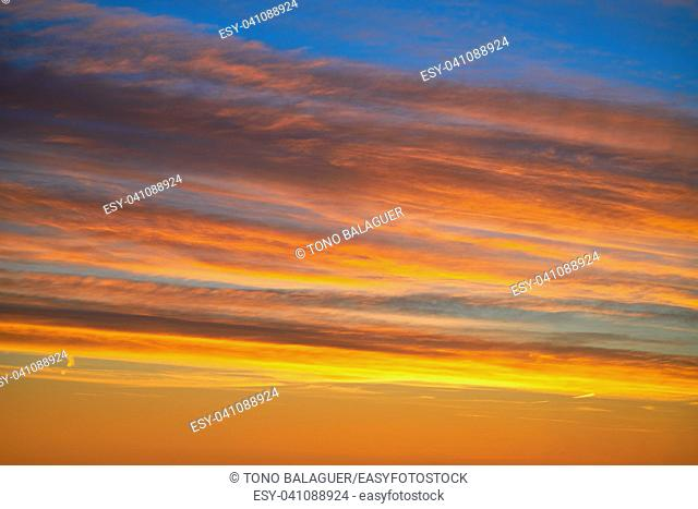 Sunset clouds sky in orange and blue background