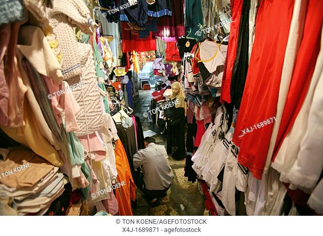 Material, linen and clothes for sale at a market in the old city section of Jerusalem