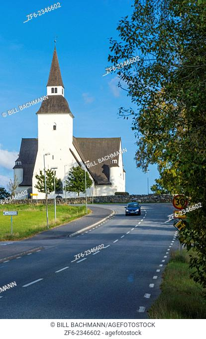 Sorunda Sweden beautiful white church and car on road in small picturesque town south of Stockholm