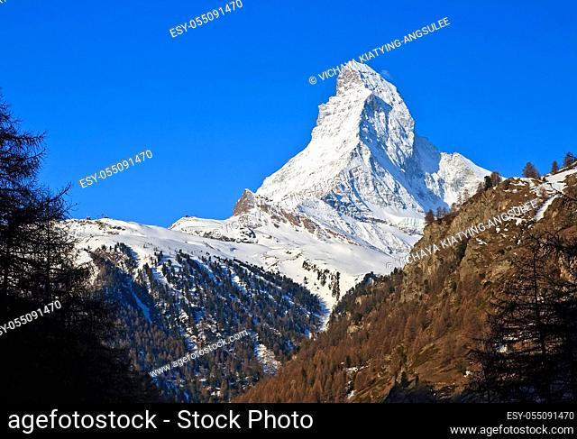 Matterhorn peak over blue sky, Alps in Switzerland