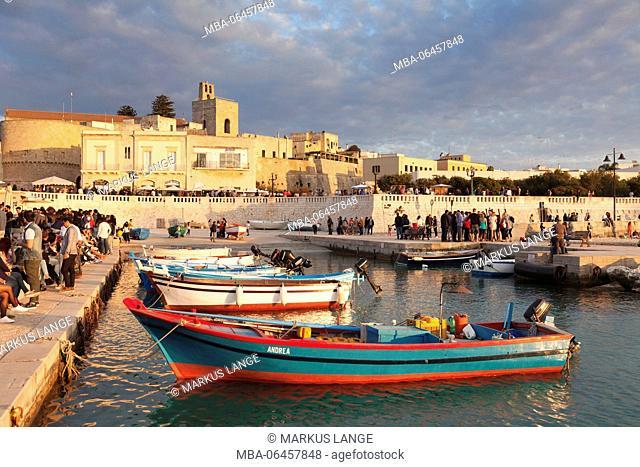 Passeggiata (strolling) in the harbour of Otranto, province of Lecce, Salento peninsula, Apulia, Italy