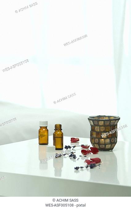 Aroma oil with lavender flower on table, close up