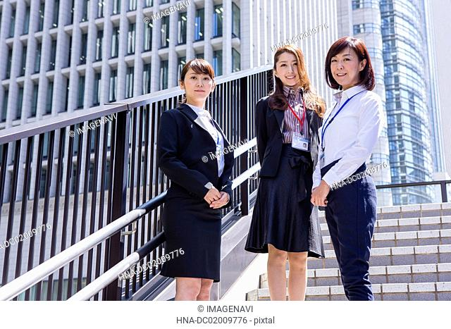 Business women standing on the stairs at downtown area