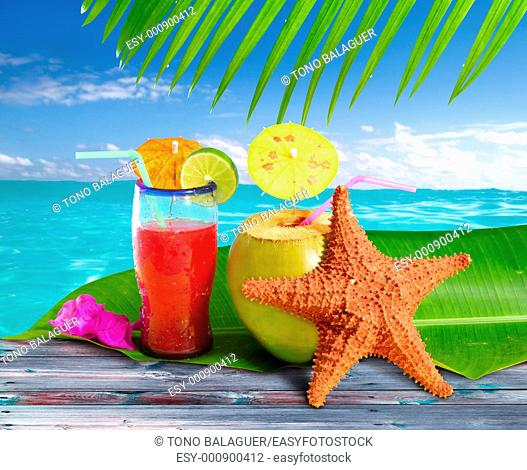 coconuts cocktails straw tropical caribbean beach with starfish