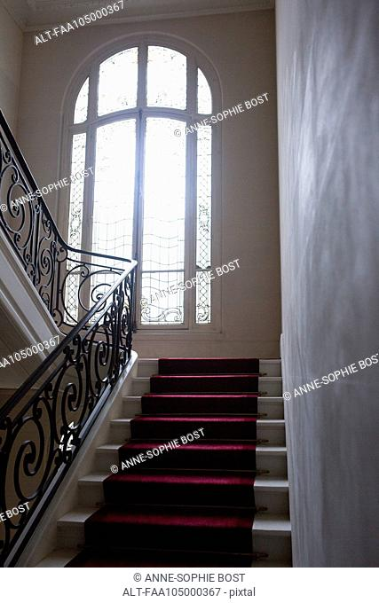 Stairway with wrought iron bannister
