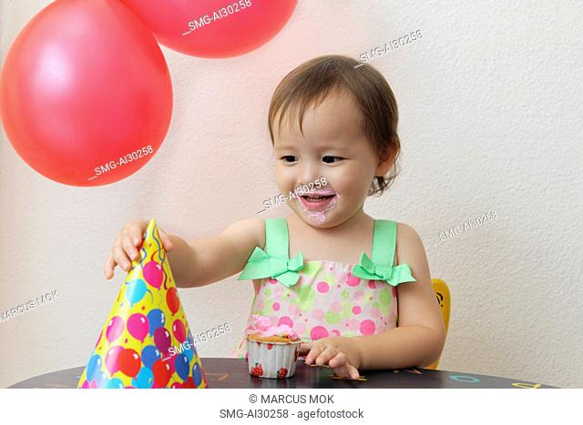 Young girl at birthday party
