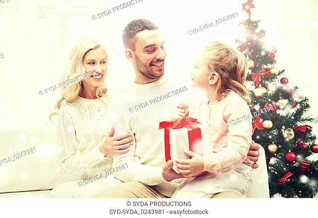 happy family at home with christmas gift