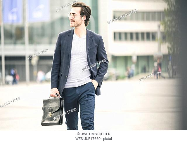 Confident businessman walking in the city