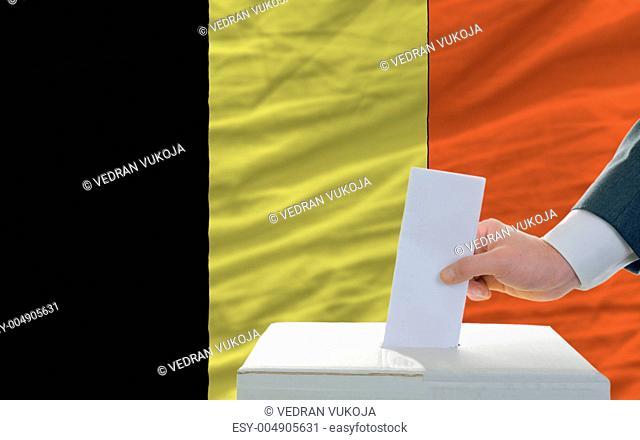 man voting on elections in belgium