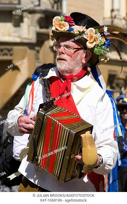 Morris musician playing dance tunes on a melodeon to accompany the morris dancing at the Oxford Folk festival