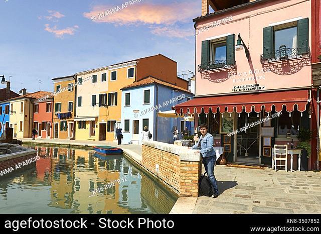 Medium age woman looking at camera in Burano Island, Venice, Veneto, Italy, Europe