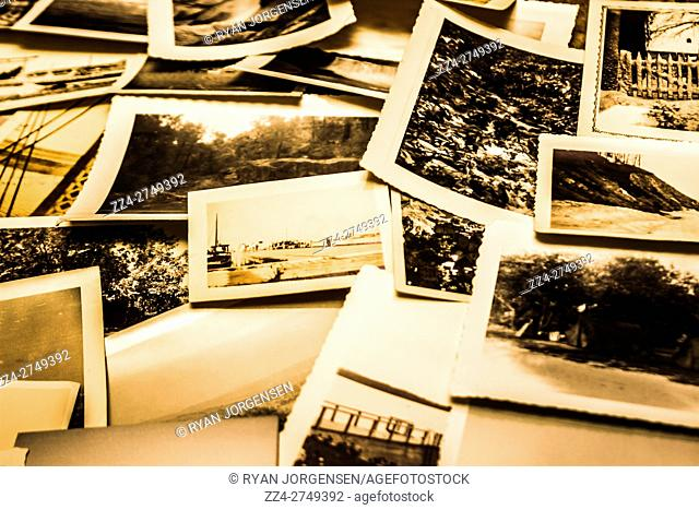 A set of various scattered aged and faded instant film photos. Scattered memories