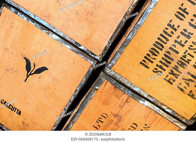 close-up picture of used wooden tea-boxes, diagona