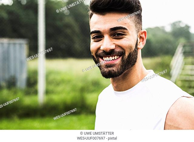 Portrait of smiling athlete outdoors