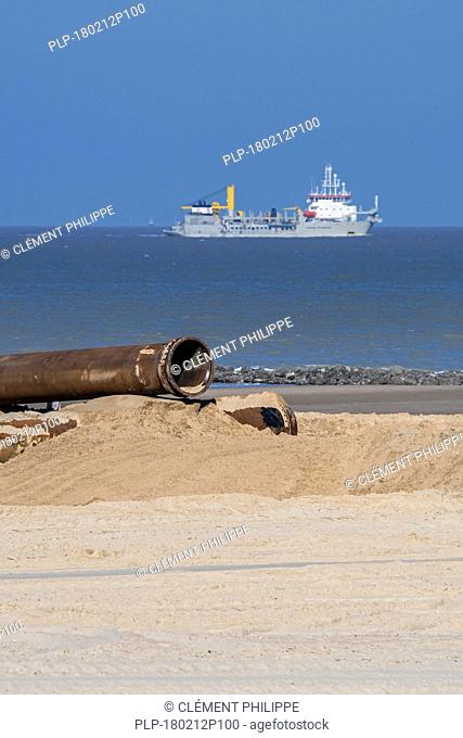 Trailing suction hopper dredger at sea and pipeline for sand replenishment / beach nourishment to reduce storm damage along the Belgian coast