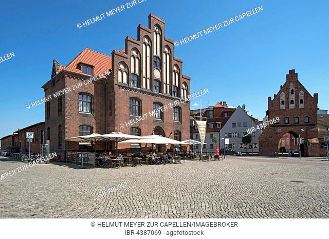 Old customs house with water gate in the Old Port, Wismar, Mecklenburg-Western Pomerania, Germany