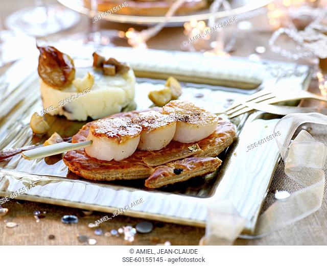 Scallop brochette on flaky pastry