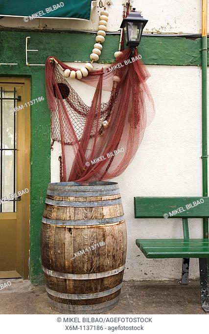 barrel and fishnet in a tabern entrance  Etxetxu square  Puerto Viejo Old Port  Getxo, Biscay, Basque Country, Spain, Europe
