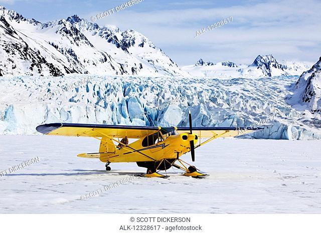 Piper Super Cub plane, Kenai Mountains, Kachemak Bay State Park, Grewingk Glacier, Southcentral Alaska; Alaska, United States of America