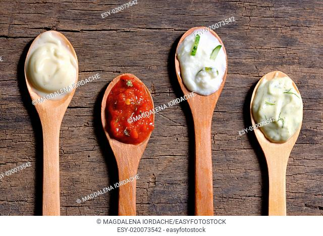 different types of sauces in spoons