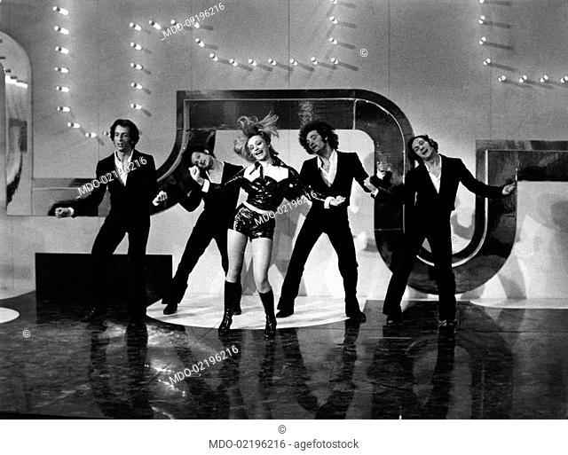 Italian dancer and presenter Raffaella Carrà performing together with some dancers during the TV programme Un disco per l'estate