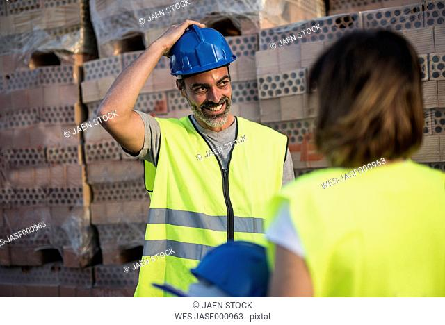 Construction worker trying on hard hat