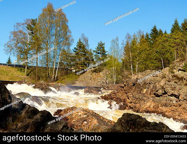 Boenfossen, the waterfall at Boen, in the popular salmon river Tovdalselva, in Kristiansand, Norway. This river is popular for salmon fishing