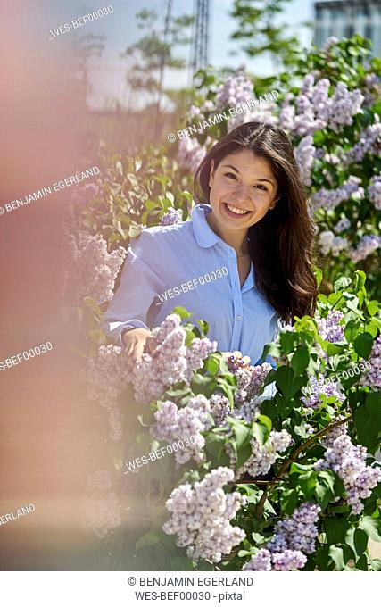 Portrait of smiling young woman enjoying nature