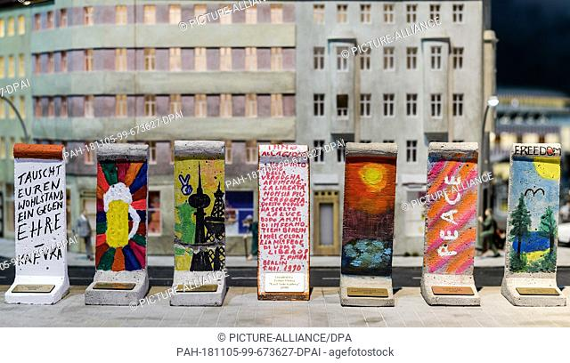 05 November 2018, Berlin: Wall elements designed by celebrities on a scale of 1:21 will be shown in the exhibition at a press event on the anniversary of the...