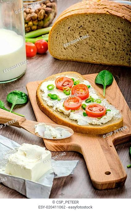 Fresh bread smeared with cream cheese