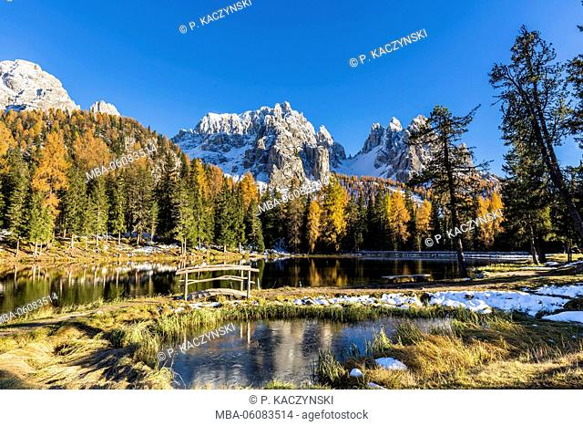 Cadini Moutain Group with colorful larch trees at Lake Antorno, autumn, UNESCO World Heritage Site, Dolomites, Veneto, Belluno Province, Italy