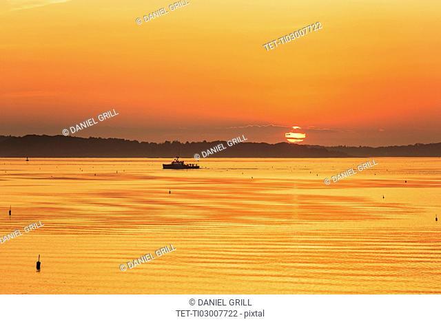 Lobstermen fishing in golden sunrise