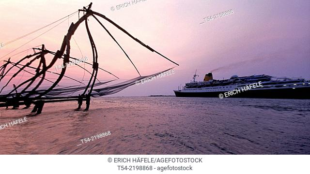 Passenger ship cross the Chinese fishing nets in Cochi