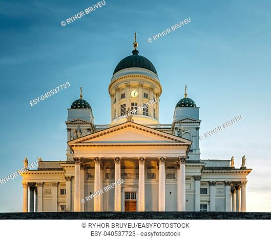Famous Landmark In Finnish Capital: Senate Square With Lutheran Cathedral And Monument To Russian Emperor Alexander Ii At Summer Sunset Evening