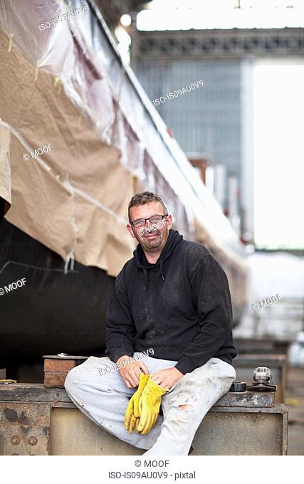 Portrait of worker in shipyard workshop