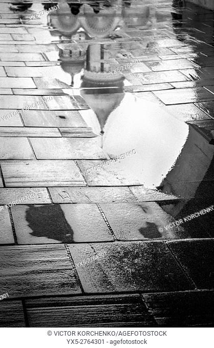 Cathedral of the Archangel reflection in a puddle in Moscow Kremlin