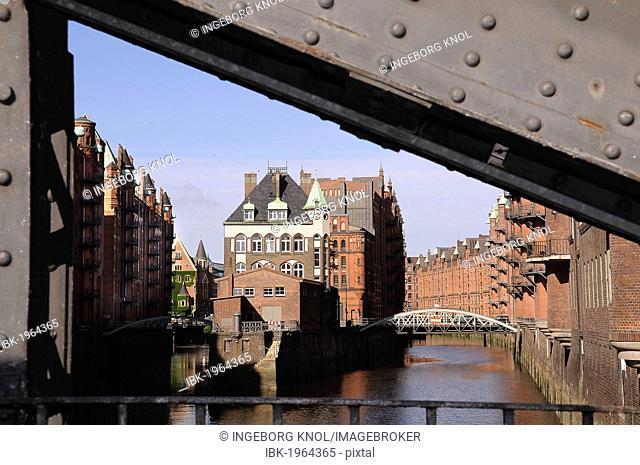 Canal with Wasserschloesschen, bridge in the foreground, Speicherstadt historic warehouse district, Hamburg, Germany, Europe