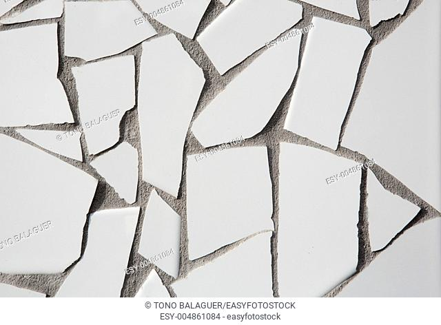 trencadis mosaic of white broken tiles in Mediterranean with cement gray joints