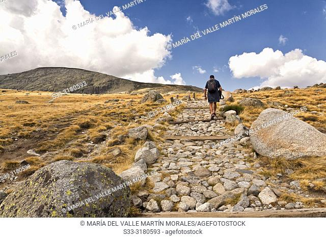 Walking by The Long Lagoon Path in the Sierra de Gredos. Avila. Spain