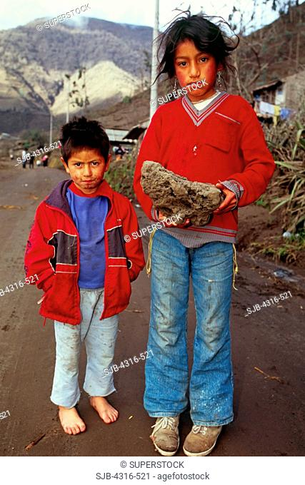 Young Residents of Penipe Village Show Off a Volcanic Rock That Crashed Through the Roof of Their Home