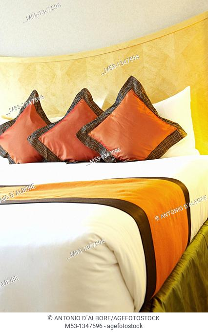 elegant bed setting with silk pillows  Selective focus on the pillows