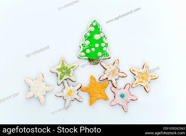 Christmas traditional cookies in shape of new year tree and stars