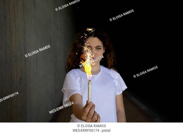 Girl holding sparkler in the dark