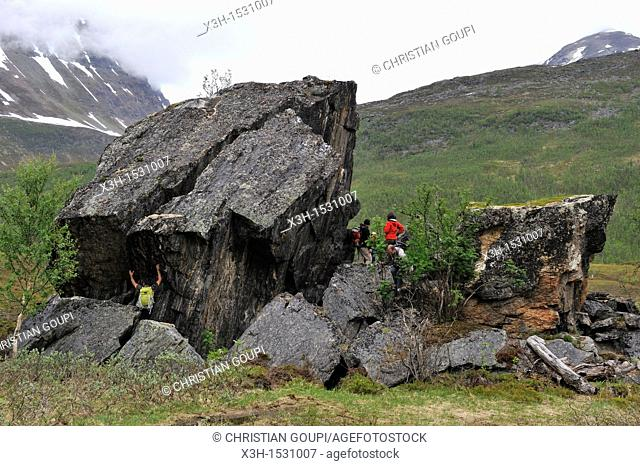 isolated huge rock in Nordmannvikdalen valleycalled Church Rock in reference to Sami people mythology, region of Lyngen, County of Troms, Norway
